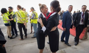 Brussels airport employees celebrate after the first flight took off on Sunday