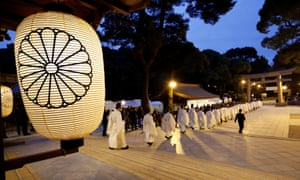 Shinto priests walk in a line to attend a ritual to usher in the New Year in Tokyo, Japan.
