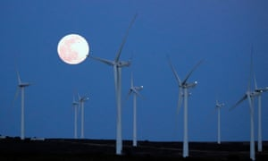 The super Full Worm Moon rises over a wind turbine farm in March