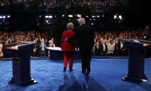 Hillary Clinton and Donald Trump greet the audience at the end of the first presidential debate
