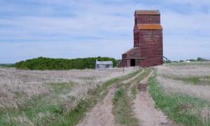 A wood-cribbed grain elevator along highway 17 in Alberta.