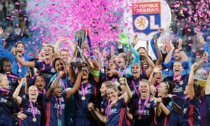 Lyon celebrate winning the Champions League after beating Wolfsburg in the final. How many Lyon players will be in the Guardian's top 100?