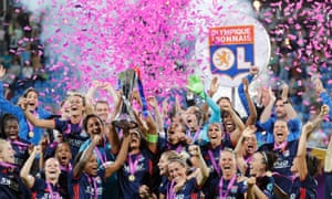 Lyon captain Wendie Renard lifts the Champions League trophy with her team-mates.