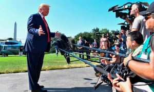 Donald Trump speaks to the press on the White House lawn before departing Washington DC.