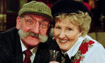 Paula Tilbrook as Betty Eagleton and Stan Richards as Seth Armstrong at the Valentine's Day karaoke night at the Woolpack in Emmerdale, 2002.