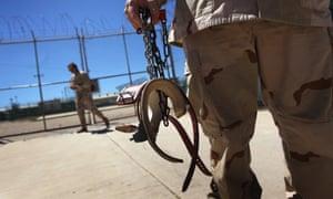 Guantanamo guard holding shackles