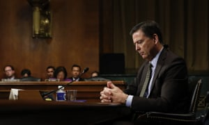 Former FBI Director James Comey pauses as he testifies on Capitol Hill in Washington, before a Senate judiciary committee hearing.