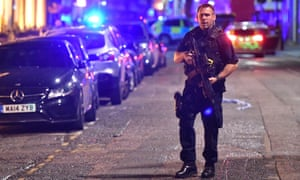 An armed police officer on Borough High Street following the London Bridge terrorist attack in June 2017.