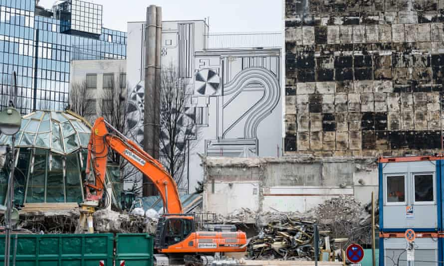 The mural is revealed as demolition work takes place