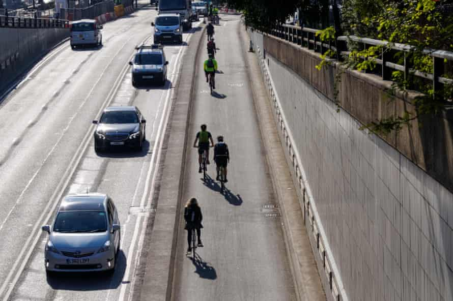 Cyclists on the separated cycle superhighway on under London's Blackfriars bridge