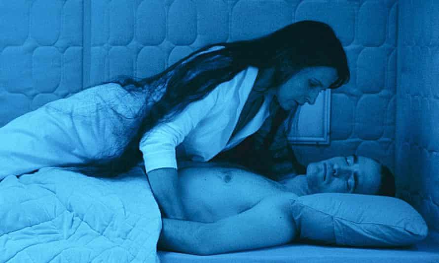 Pure radioactive strangeness … Juliette Binoche and Robert Pattinson.