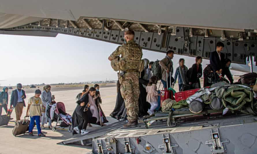 British citizens are evacuated from Kabul on a military plane.