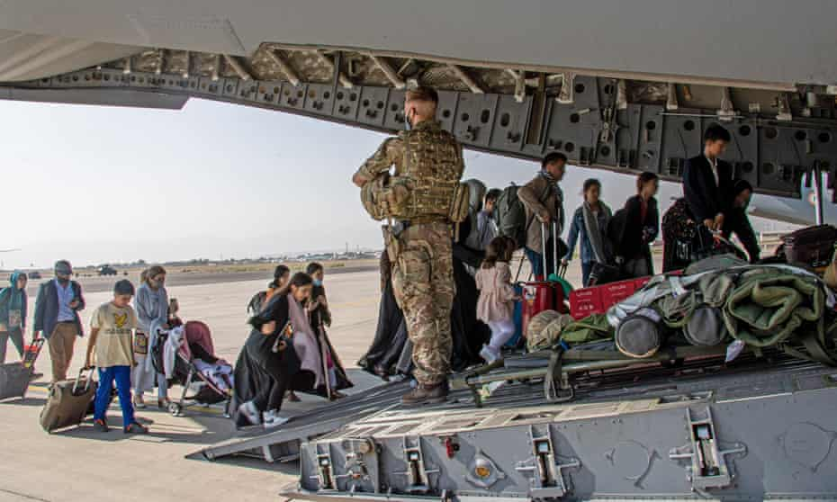 British citizens and dual nationals board a military plane at Kabul airport.