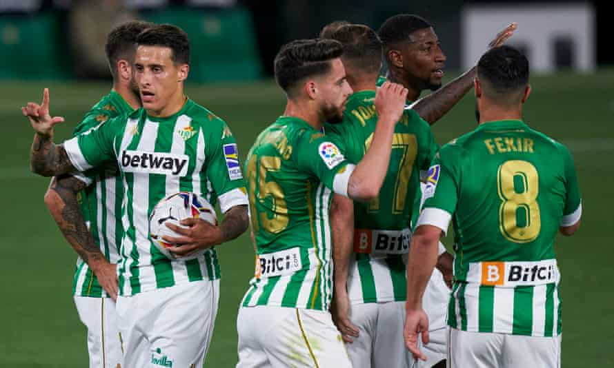 Cristian Tello celebrates Real Betis's equaliser against Atlético as Diego Simeone's team went top but lost points on Real Madrid.