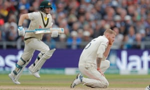 England's Ben Stokes looks on as Australia's Steve Smith adds another run to the score.