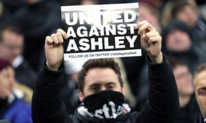 File photo dated 29-01-2019 of Newcastle United fans hold up banners in protest against owner Mike Ashley.
