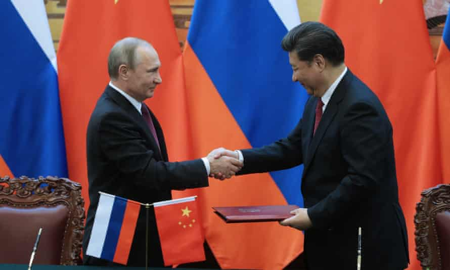 Russia's president Vladimir Putin and China's president Xi Jinping shake hands at the signing of documents following Russian-Chinese talks.