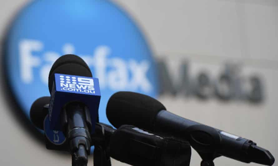 A Nine microphone in front of a Fairfax sign