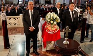 Men stand next to the coffin of former Cypriot president Christofias