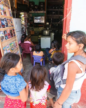 Children watch the broadcast in Loreto, Peru.