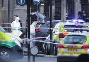 Police forensic officers close to the Palace of Westminster