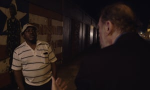 Larry Charles talking to General Butt Naked.