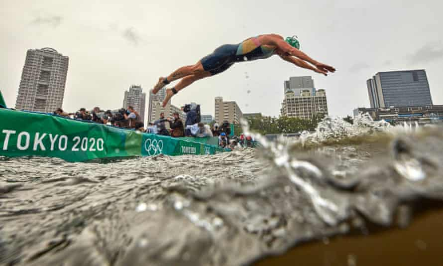 Flora Duffy dives into the water to begin her Olympic triathlon bid.