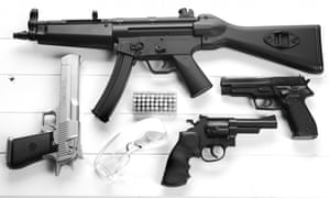 An assortment of weapons including a Heckler & Koch MP5.