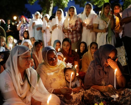 Sikhs attend a vigil in Wisconsin in 2012 after six worshipers were killed.