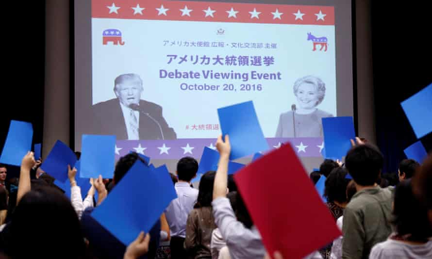 Students attend an event to watch the US presidential debate on television in Tokyo.