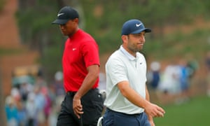 Tiger Woods (left) overtook Francesco Molinari (right) on the final day.