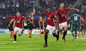 Catch me if you can: Marcus Rashford celebrates his late winner at Hull, with Wayne Rooney and Zlatan Ibrahimovic in pursuit.