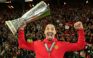 Zlatan Ibrahimovic holds the Europa League trophy aloft in 2017.