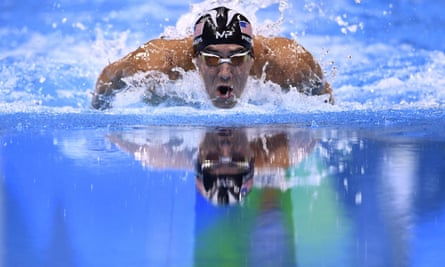 USA's Michael Phelps storms to victory in the men's 200m individual medley final, claiming his 22nd gold medal.