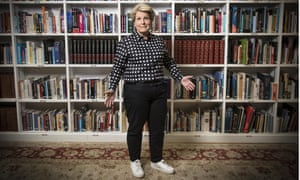 Sandi Toksvig in front of bookshelves
