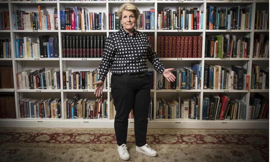 Sandi Toksvig in front of bookshelves