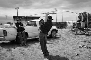 Bronc Pippert performs some roping magic for friends during a break from the first annual Neal Hermanson Ranch Rodeo in Sidney, Montana.