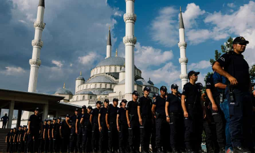 Turkish police officers attend the funeral ceremony of a special forces officer killed during the failed coup.