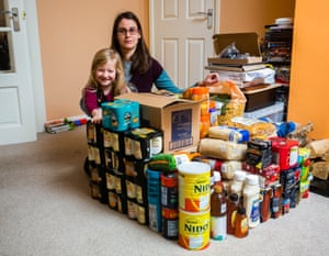 Nevine Mann with her daughter, Paige, and some of her Brexit supplies … 'We're expecting it to be pretty horrendous.'