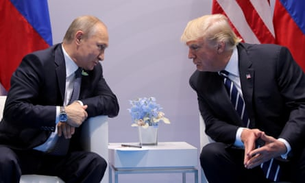 Vladimir Putin speaking with Donald Trump at the G20 summit in Hamburg last July.