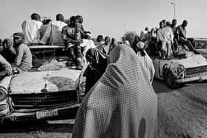 People outside an IDP camp in Maiduguri waiting to head out to the fields to farm