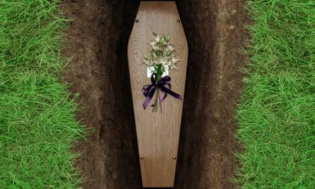 Coffin in open grave