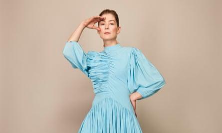 Rosamund Pike in a blue dress