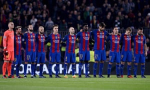 Barcelona's players observe a minute's silence