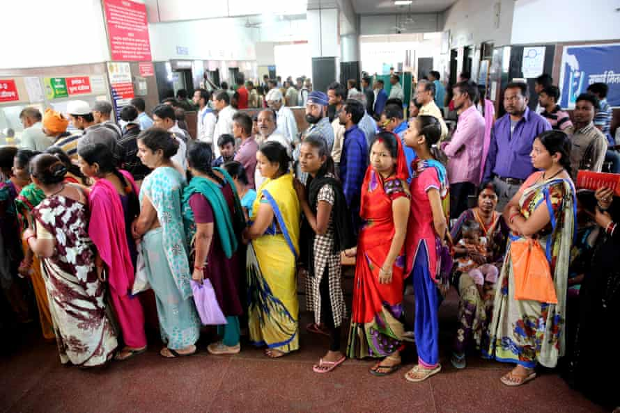 Patients queue for treatment following an outbreak of dengue fever in Bhopal, India this month.