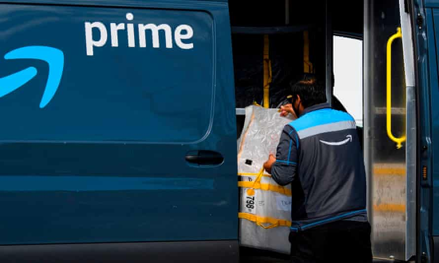 An Amazon delivery driver loads a van outside of a distribution facility in Hawthorne, California.