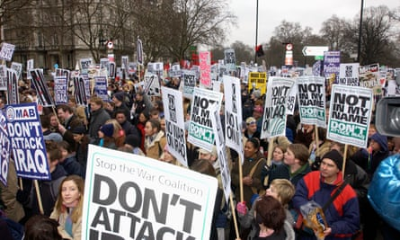 Demonstrators take part in massive anti-war demonstration in London in February 2003.