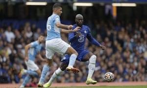 Chelsea's Romelu Lukaku tussles with Rodri of Manchester City.