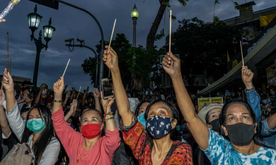 Protesters wave wands at a Harry Potter-themed protest in Bangkok, amid growing anger at the government and monarchy.