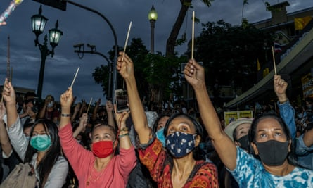 Image of Thai protesters with Wands Up Harry Potter gesture from The Guardian